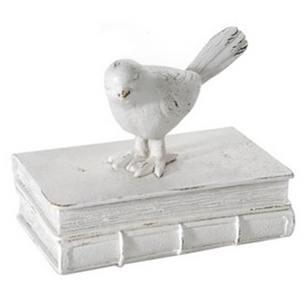 Dekoration Vogel auf einem Buch in Weiß